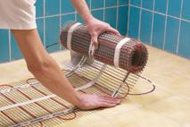 Poser rouleaux plancher rayonnant électrique