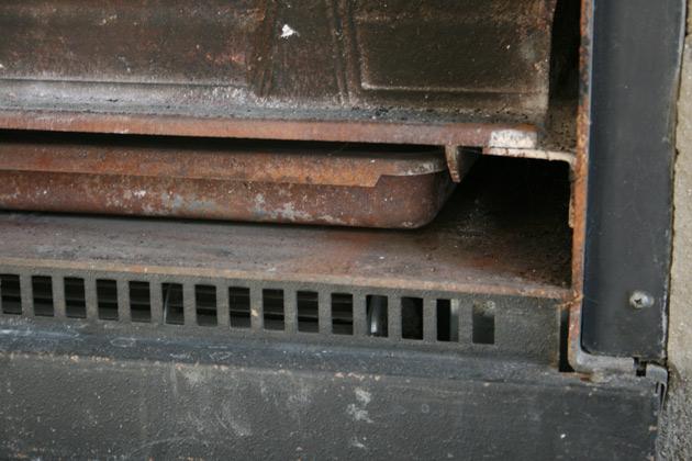 insert-cheminee-en-fonte-rouille